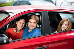 Couple Sitting In Newly Purchased Car. Happy Couple Sitting With Their Daughter In Newly Purchased Car Royalty Free Stock Photography