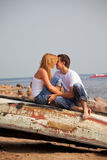 Couple sitting on old boat and kiss Stock Photo
