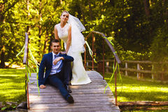 Couple Sitting On The Bridge Stock Photos