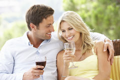 Couple Sitting On Outdoor Seat Together Stock Photography