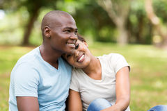 Couple sitting outdoors Royalty Free Stock Photos
