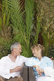 Couple Sitting Outdoors On Chairs Talking Royalty Free Stock Photography