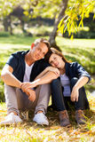 Couple sitting outdoors Stock Photography