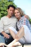 Couple sitting outside Royalty Free Stock Photos