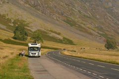 Couple sitting outside campervan by the road - Glencoe, Scotland, UK Stock Images
