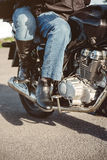 Couple sitting over motorcycle ready to go Royalty Free Stock Photography