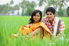 Couple sitting in a paddy field Royalty Free Stock Photos