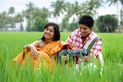 Couple sitting in the paddy field Stock Image
