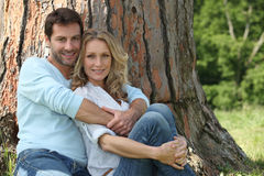 Couple sitting in a park Royalty Free Stock Image