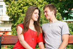 Couple sitting on park bench Stock Images