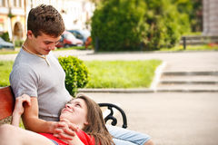 Couple sitting on park bench Stock Photos