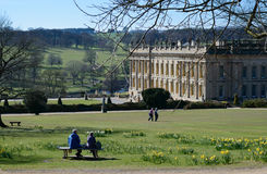 Couple sitting on park bench, Chatsworth House Royalty Free Stock Image