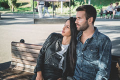 Couple sitting on a park bench enjoying the view Stock Photography