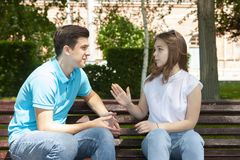 Couple sitting in park having relationship problems stock images