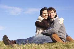 Couple Sitting In Park Together Stock Photos