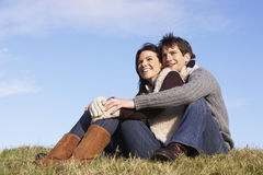 Couple Sitting In Park Together Stock Images