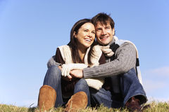 Couple Sitting In Park Together royalty free stock image