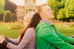 Couple sitting in park Stock Photo