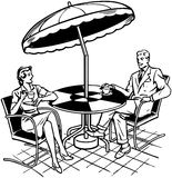 Couple Sitting On Patio Stock Images