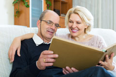 Couple sitting with photograph album Royalty Free Stock Photo