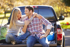 Couple Sitting In Pick Up Truck On Camping Holiday Royalty Free Stock Photography