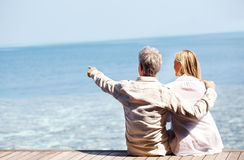 Couple sitting on the pier Royalty Free Stock Photography