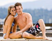 Couple sitting on pier Royalty Free Stock Photo