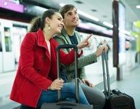 Couple sitting at platform Royalty Free Stock Photography