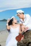Couple sitting playing guitar Stock Photo