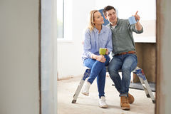 Couple Sitting In Property Being Rennovated Stock Images