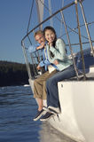 Couple Sitting At Railing On Sailboat Royalty Free Stock Photos