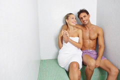 Couple sitting in relaxation room Royalty Free Stock Images