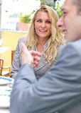 Couple sitting in a restaurant Royalty Free Stock Images
