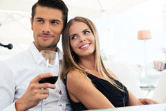 Couple sitting in restaurant Stock Photo