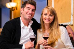 Couple is sitting at restaurant Royalty Free Stock Images