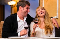Couple is sitting at restaurant Stock Photo