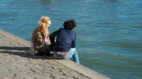 Sitting on the riverside in Paris royalty free stock photo