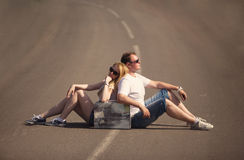 Couple sitting on the road Royalty Free Stock Images