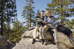 Couple Sitting On Rock Stock Photography
