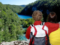 Couple sitting on rock in Plitvice, Croatia, UNESC Royalty Free Stock Images