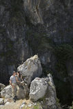 Couple Sitting On Rocks Stock Photos
