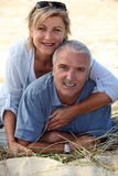 Couple sitting on a sand dune Royalty Free Stock Photography