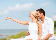 Couple sitting at sea side Stock Photography