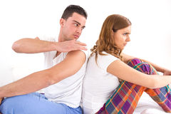Couple sitting separately from each other on the bed Royalty Free Stock Image