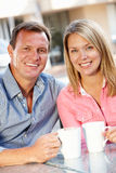 Couple sitting at sidewalk cafe Stock Images