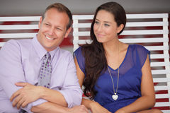 Couple sitting and smiling Royalty Free Stock Photos