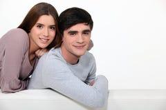 Couple sitting on a sofa Royalty Free Stock Photo