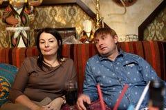 Couple sitting on sofa Stock Photography