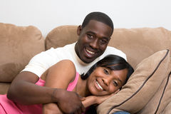 Couple Sitting on Sofa - Close-Up, Horizontal Stock Image