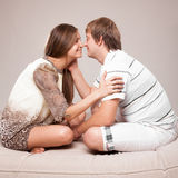 Couple sitting on sofa face to face Royalty Free Stock Image